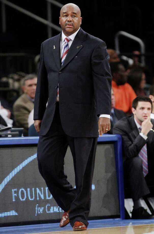Georgetown head coach John Thompson III watches his team play during the first half of their NCAA college basketball game against Texas in the Jimmy V Classic at Madison Square Garden, Tuesday, Dec. 4, 2012, in New York. Georgetown won 64-41. Photo: Frank Franklin II, Associated Press / AP