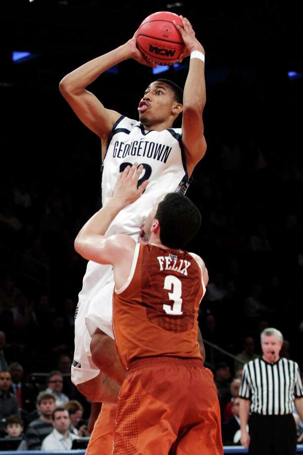 Georgetown's Otto Porter shoots over Texas' Javan Felix (3) during the first half of their NCAA college basketball game in the Jimmy V Classic at Madison Square Garden, Tuesday, Dec. 4, 2012, in New York. Photo: Frank Franklin II, Associated Press / AP