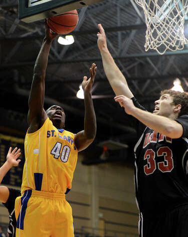 St. Mary's Isaiah Matthews (4) takes a shot over UIW's Anthony Horton (33) during a Men's NCAA Division II basketball game between the Incarnate Word University Cardinals and the St. Mary's University Rattlers at Bill Greehey Arena, Tuesday, December 4, 2012. Photo: John Albright, For The Express-News / San Antonio Express-News
