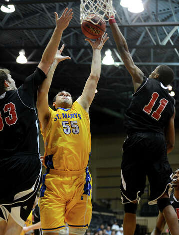 St. Mary's Kevin Kotzur (55) takes a shot between two UIW' players during a Men's NCAA Division II basketball game between the Incarnate Word University Cardinals and the St. Mary's University Rattlers at Bill Greehey Arena, Tuesday, December 4, 2012. Photo: John Albright, For The Express-News / San Antonio Express-News