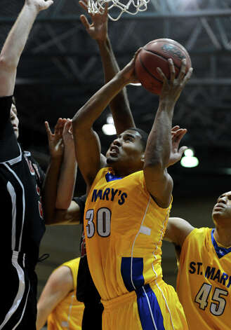 St. Mary's John Roberts (30) tries to get off a shot from under the basket during a Men's NCAA Division II basketball game between the Incarnate Word University Cardinals and the St. Mary's University Rattlers at Bill Greehey Arena, Tuesday, December 4, 2012. Photo: John Albright, For The Express-News / San Antonio Express-News