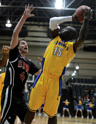 St. Mary's Moses Sundufu (15) takes a shot as UIW's Kyle Hittle (4) defends during a Men's NCAA Division II basketball game between the Incarnate Word University Cardinals and the St. Mary's University Rattlers at Bill Greehey Arena, Tuesday, December 4, 2012. Photo: John Albright, For The Express-News / San Antonio Express-News