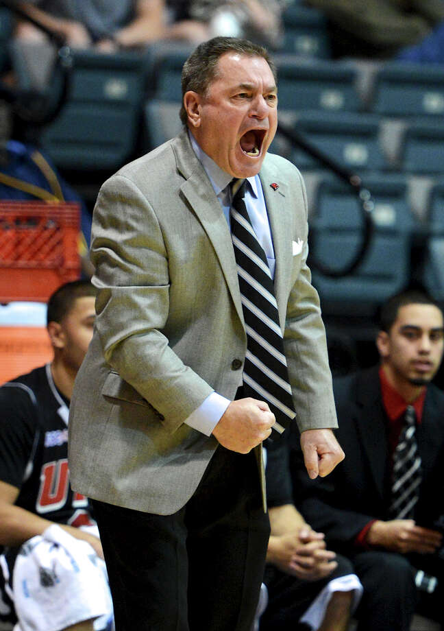 Incarnate Word head coach Ken Burmeister shout instructions to his team during a Men's NCAA Division II basketball game between the Incarnate Word University Cardinals and the St. Mary's University Rattlers at Bill Greehey Arena, Tuesday, December 4, 2012. Photo: John Albright, For The Express-News / San Antonio Express-News