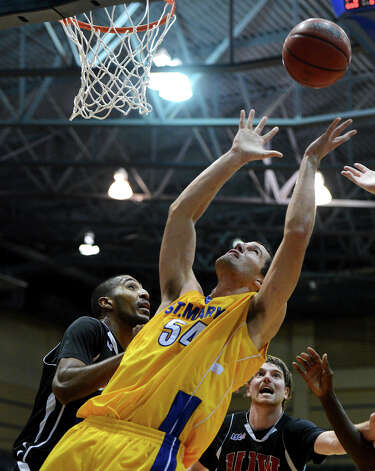 St. Mary's Justin Alexander (54) goes up for a rebound during a Men's NCAA Division II basketball game between the Incarnate Word University Cardinals and the St. Mary's University Rattlers at Bill Greehey Arena, Tuesday, December 4, 2012. Photo: John Albright, For The Express-News / San Antonio Express-News