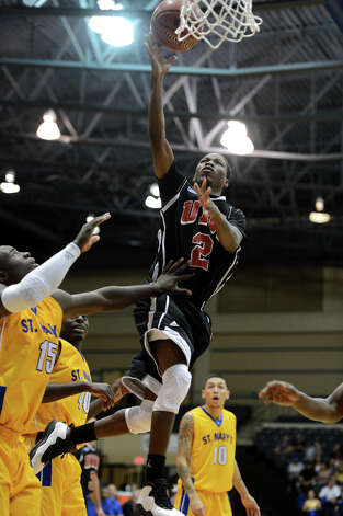 Incarnate Word's Lyn'Dale Brown (2) takes a shot in the lane during a Men's NCAA Division II basketball game between the Incarnate Word University Cardinals and the St. Mary's University Rattlers at Bill Greehey Arena, Tuesday, December 4, 2012. Photo: John Albright, For The Express-News / San Antonio Express-News