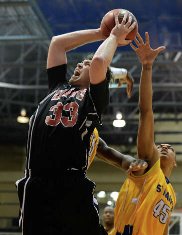 Incarnate Word's Anthony Horton (33) takes a shot during a Men's NCAA Division II basketball game between the Incarnate Word University Cardinals and the St. Mary's University Rattlers at Bill Greehey Arena, Tuesday, December 4, 2012. Photo: John Albright, For The Express-News / San Antonio Express-News