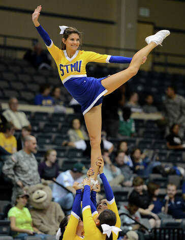 St. Mary's cheerleader preforms during a Men's NCAA Division II basketball game between the Incarnate Word University Cardinals and the St. Mary's University Rattlers at Bill Greehey Arena, Tuesday, December 4, 2012. Photo: John Albright, For The Express-News / San Antonio Express-News