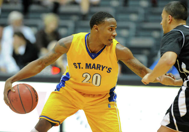 St. Mary's Mark Simmons (20) brings the ball up the court during a Men's NCAA Division II basketball game between the Incarnate Word University Cardinals and the St. Mary's University Rattlers at Bill Greehey Arena, Tuesday, December 4, 2012. Photo: John Albright, For The Express-News / San Antonio Express-News
