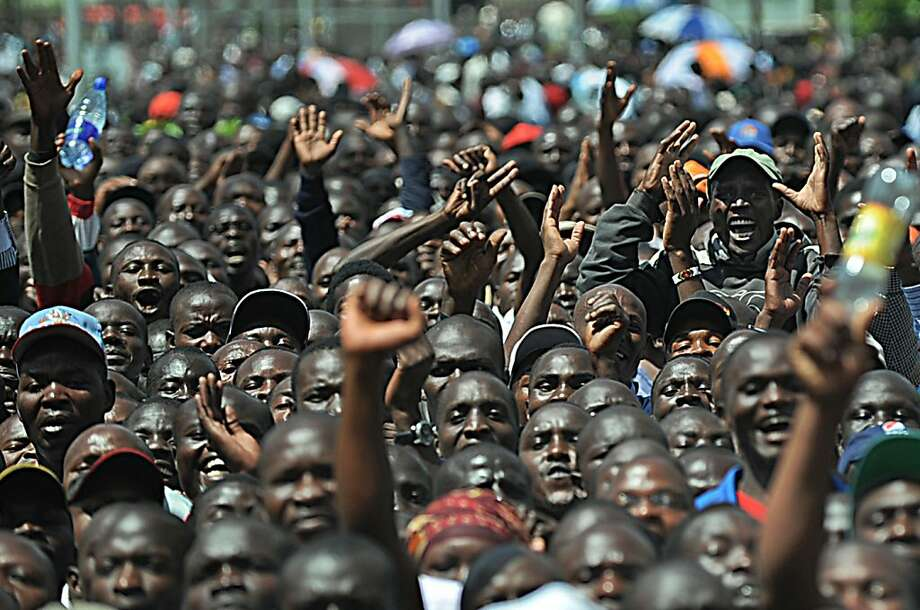 Supporters chant as they raise their arms after Kenya's Prime Minister, Vice President and Trade Minister among others announced a powerful alliance on December 4, 2012 as running mates in upcoming Kenyan presidential elections due in March. Kenya's Prime Minister Raila Odinga and Vice President Kalonzo Musyoka along with Wetangula and leaders of ten other smaller parties, signed an agreement in front of thousands of supporters to form the Coalition for Reform and Democracy (CORD) party which rivals another coalition between deputy Prime minister, Uhuru Kenyatta with opposition politician, William Ruto both of whom face indictments at the Hague based International Criminal Court (ICC). Odinga is widely tipped to be the presidential candidate with Musyoka as his deputy, although no formal announcement was made. Photo: Tony Karumba, AFP/Getty Images
