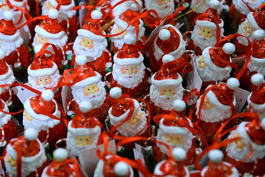 Santa Claus decorations are pictured on December 4, 2012 at the Galeries Lafayette Paris department store, ahead of the Christmas celebrations. Photo: Miguel Medina, AFP/Getty Images