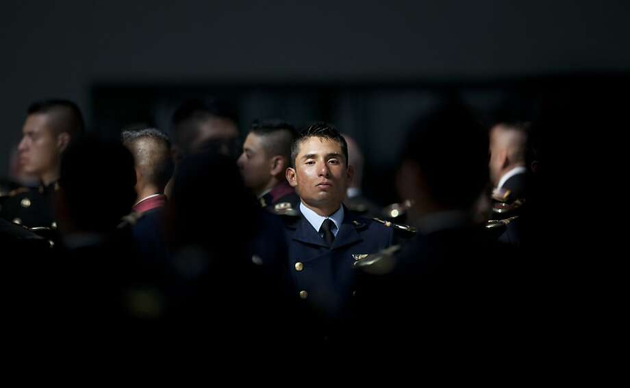Cadets stand at attention during the playing of the national anthem after a breakfast celebrating Mexico's President Enrique Pena Nieto's first visit to the Heroic Military College in Mexico City, Tuesday, Dec. 4, 2012. Photo: Alexandre Meneghini, Associated Press