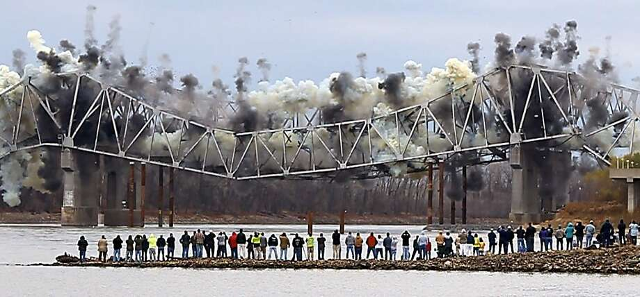 In this video framegrab, Spectators watch as the westbound sections of the Blanchette Bridge on I-70 are demolished on Tuesday, Dec. 4, 2012 in St. Charles, Mo.  Crews used explosives to take down the sections of the bridge that connects St. Louis and St. Charles counties along Interstate 70. The work is part of a $63 million rehabilitation project. Photo: Robert Cohen, Associated Press