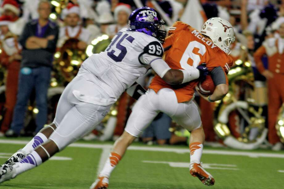 DEFENSIVE NEWCOMER OF YEAR Devonte Fields, TCU: The 6-4 freshman from Arlington Martin — seen here sacking Texas quarterback Case McCoy — notched 32 tackles, 17 assists and an interception to become a key contributor for a Horned Frogs defense that featured only one senior starter. Fields had nine sacks and 17½ tackles for losses to lead all freshman nationally. He led the Big 12 in tackles for losses and ranked second in sacks. Photo: Jack Plunkett, Associated Press / FR59553 AP