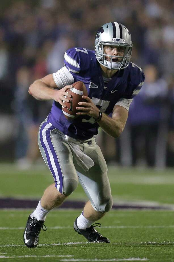 OFFENSIVE PLAYER OF YEAR Collin Klein, Kansas State: The Heisman finalist became the first player from a BCS automatic qualifying school in the modern era to rush for at least 20 touchdowns and pass for 10 touchdowns in multiple seasons. He has accounted for 37 touchdowns to rank 11th nationally and he leads all quarterbacks with 22 rushing touchdowns. His current pass efficiency rating of 156.12 ranks third in school history. Photo: Charlie Riedel, Associated Press / AP