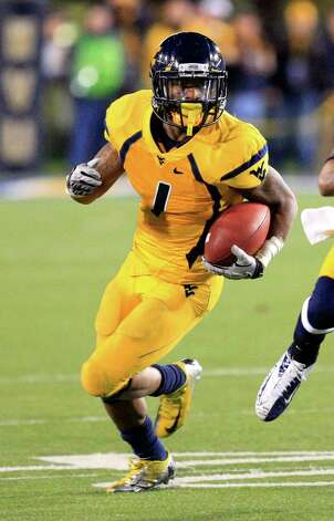 FIRST TEAM OFFENSE  All-purpose: Tavon Austin, WVU, 5-9, 174, Sr., Baltimore (Dunbar) Photo: Christopher Jackson, Associated Press / FRE 170573 AP