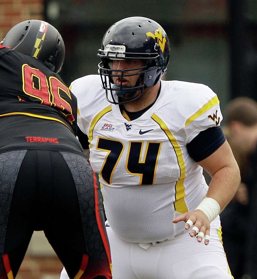 FIRST TEAM OFFENSE  C: Joe Madsen, WVU, 6-4, 310, Sr., Chardon, Ohio Photo: Patrick Semansky, Associated Press / AP