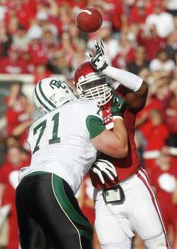 SECOND TEAM OFFENSE  OL: Cameron Kaufhold, BU, Sr. Seen here blocking against Oklahoma defensive back Brandon Young (right). Photo: Sue Ogrocki, Associated Press / AP