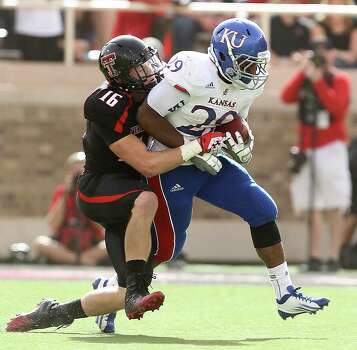 SECOND TEAM OFFENSE  RB: James Sims, KU, Jr. Seen here trying to break the tackle of Texas Tech's Cody Davis. Photo: Zach Long, AP Photo/Lubbock Avalanche-Journal / Lubbock Avalanche-Journal