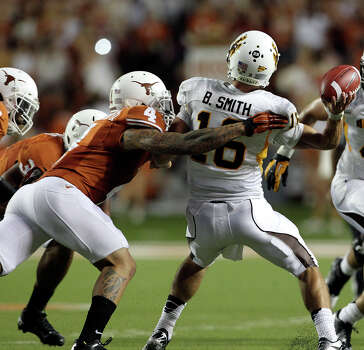 FIRST TEAM DEFENSE DB: Kenny Vaccaro, UT, 6-1, 218, Sr., Brownwood (Early). Seen here pressuring OSU quarterback Brett Smith. Photo: Tom Reel, San Antonio Express-News / ©2012 San Antono Express-News