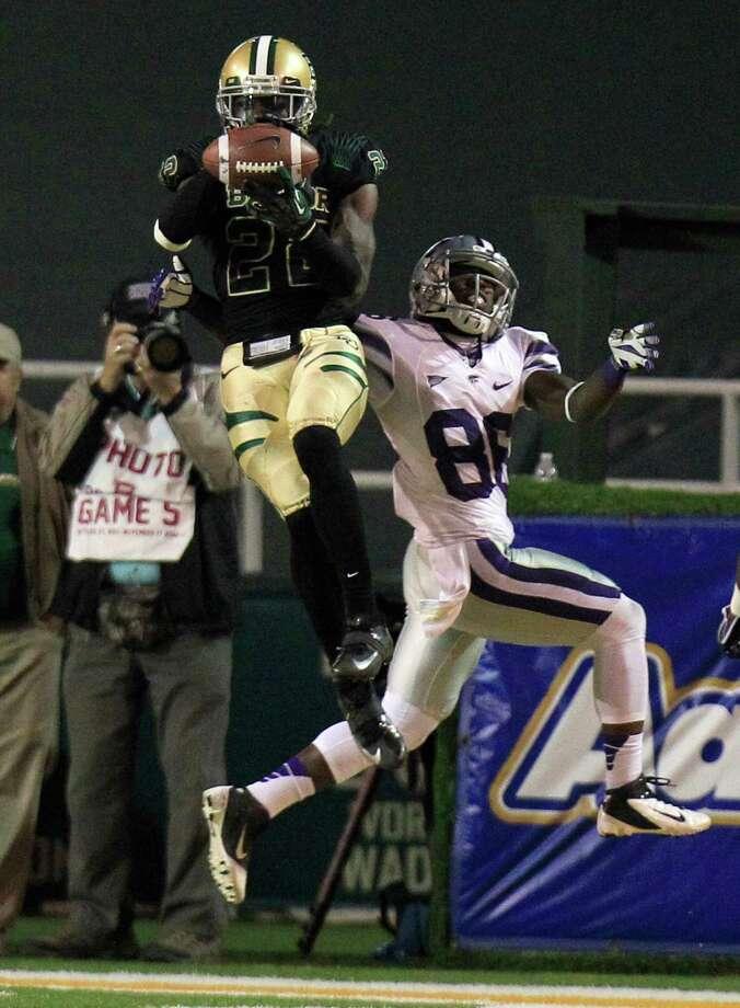 SECOND TEAM DEFENSE DB: Joe Williams, BU, Jr. Seen here intercepting a pass against Kansas State wide receiver Tramaine Thompson. Photo: LM Otero, Associated Press / AP