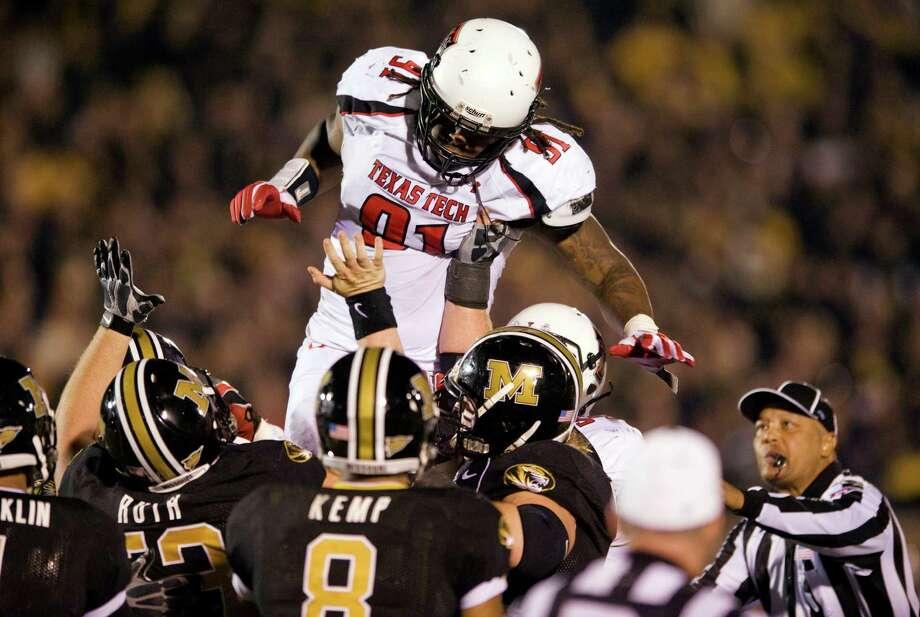 FIRST TEAM DEFENSE DL: Kerry Hyder, TT, 6-2, 275, Jr., Austin (LBJ). Seen here diving into a crowd of Missouri offensive linemen. Photo: L.G. Patterson, Associated Press