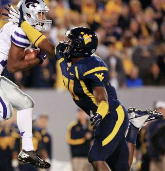 SECOND TEAM DEFENSE LB: Isaiah Bruce, WVU, Fr. Seen here trying to block a pass to Kansas State's Tyler Lockett. Photo: Christopher Jackson, Associated Press / FRE170573 AP