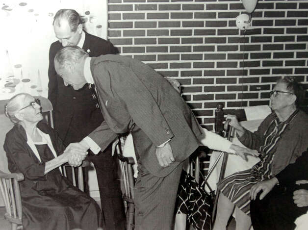President Lyndon Johnson and Congressman Jack Brook, left, greet residents at Schlesingers Geriatric Center in 1965. poto provided by Tyrrell Library Photo: Provided