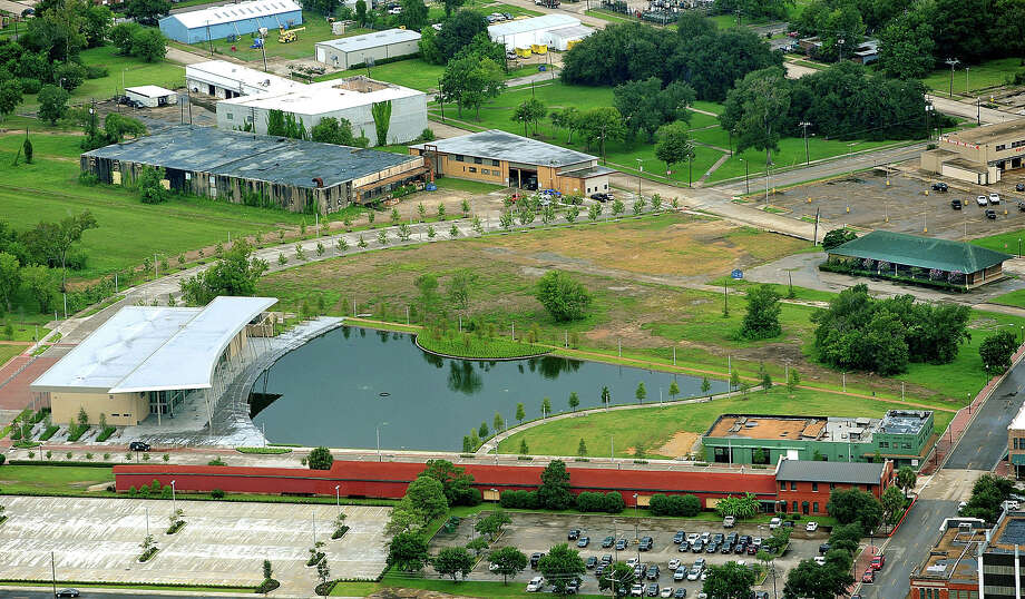 Aerial photo of Beaumont's Town Lake Centre, bottom left, the future Children's Museum, bottom right, the former Wells Fargo storage building, right, the city's new emergency storage building, directly above the Centre, and a building that is being demolished to sell its bricks. Photo taken july 24, 2012 Guiseppe Barranco/The Enterprise Photo: Guiseppe Barranco, STAFF PHOTOGRAPHER / The Beaumont Enterprise