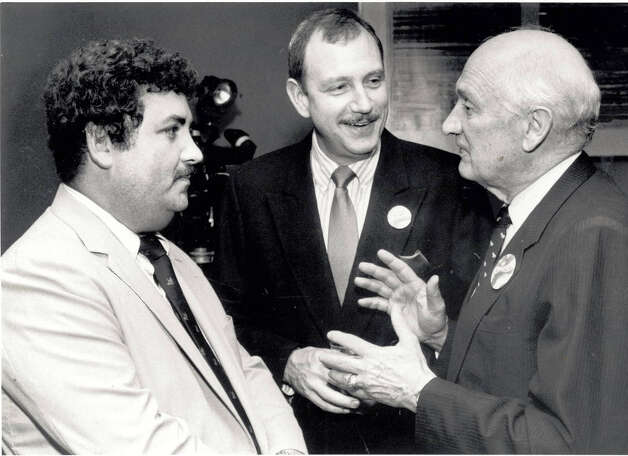 Jack Brooks talks with Lupe Flores, left, and Hank Peacock while watching election results at the Holiday Inn on 11th Street in 1988. Enterprise file photo