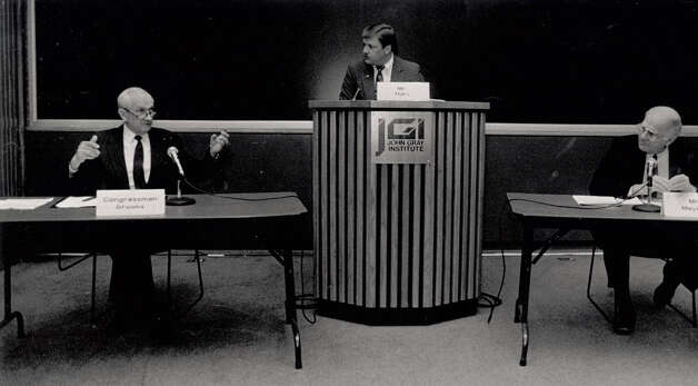 Jack Brooks answers a medicare question in 1990. Moderator John Hurt and Maury Meyers listen. Enterprise file photo