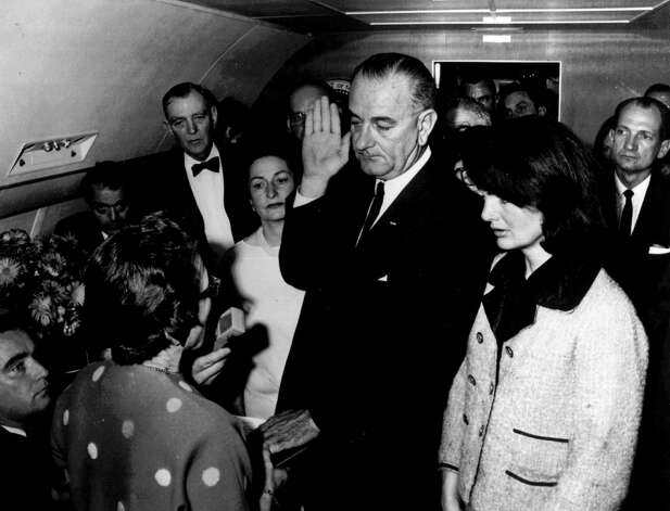 *** FILE *** Lyndon B. Johnson is sworn in as President of the United States of America in the cabin of the presidential plane as Mrs. Jacqueline Kennedy stands at his side in this Nov. 22,1963 file photo. Cecil Stoughton, the White House photographer who shot the iconic image of Lyndon B. Johnson taking the oath of office aboard Air Force One, has died. He was 88. Stoughton died Monday Nov. 3, 2008 evening at his Florida home, his son Jamie Stoughton said Tuesday. Judge Sarah T. Hughes, a Kennedy appointee to the Federal court, left, administers the oath. In background, from left are, Jack Valenti, admistrative assistant to Johnson; Rep. Albert Thomas, D-Tex.; Mrs. Johnson; and Rep. Jack Brooks,D-Tex. (AP Photo/White House, Cecil Stoughton, FILE) Photo: CECIL STOUGHTON, HO / WHITE HOUSE