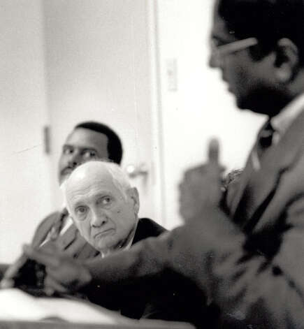 Jack Brooks listens to Port Arthur Housing Authority Executive Director Edward Jagnandan in 1992. Enterprise file photo