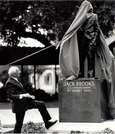 Jack Brooks watches as the curtain is removed from from his likeness at Lamar University in 1989. Enterprise file photo