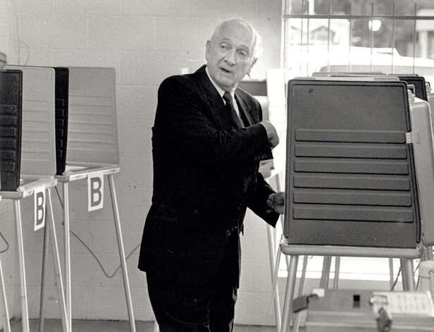 "Jack Brooks talks to voting officials as he prepares to cast his ballot at Gibson's on 11th Street in 1992. When questioned by a journalist Brooks told those in attendance he voted straight Democrat, ""as always!"" Enterprise file photo"