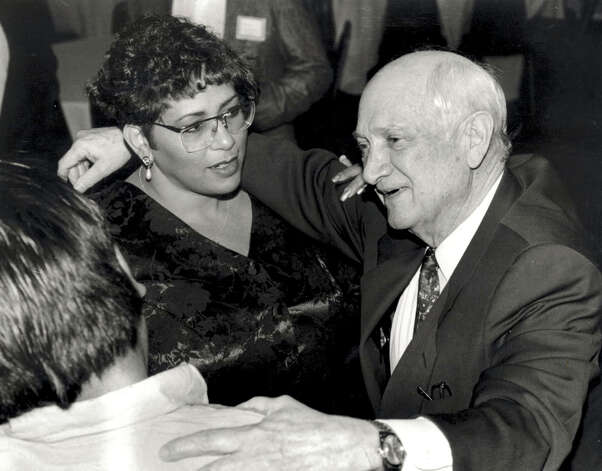 Jack Brooks greets Paula Gullory, campaign headquarters manager, and Michael Moreno at a primary victory party. Photo date unknown. Enterprise file photo