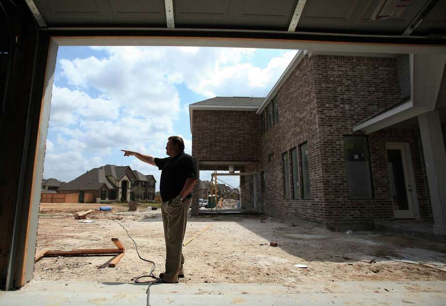 Private detective Mark Stephens looked at homes under construction in 2011 in Cypress where he was hired by homebuilders. Criminals take copper from air-conditioning units and electrical wiring in new homes. Photo: Mayra Beltran, Chronicle / Houston Chronicle