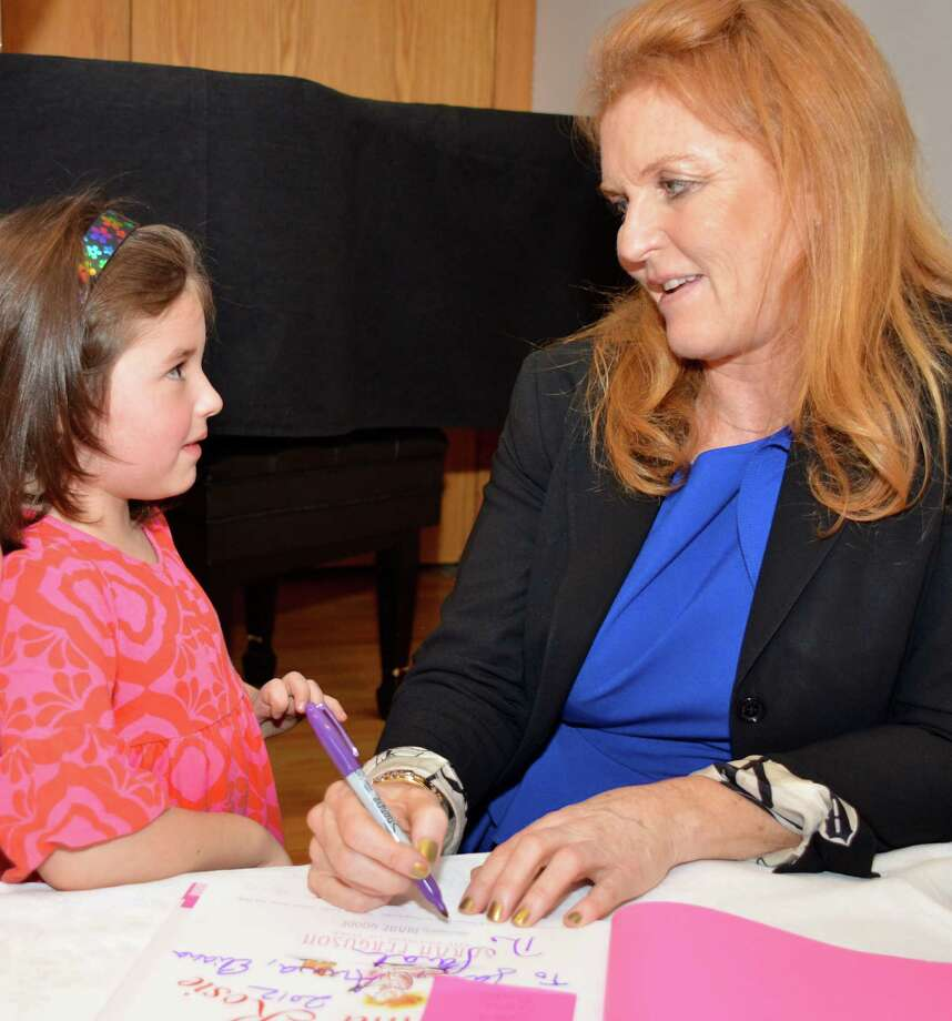 """My name is Sara, too!"" 6-year-old Sara Reiter sweetly told Sarah Ferguson, the Duchess of York, on Sunday at the New Canaan Library.  Dec. 2, 2012. Photo: Jeanna Petersen Shepard"