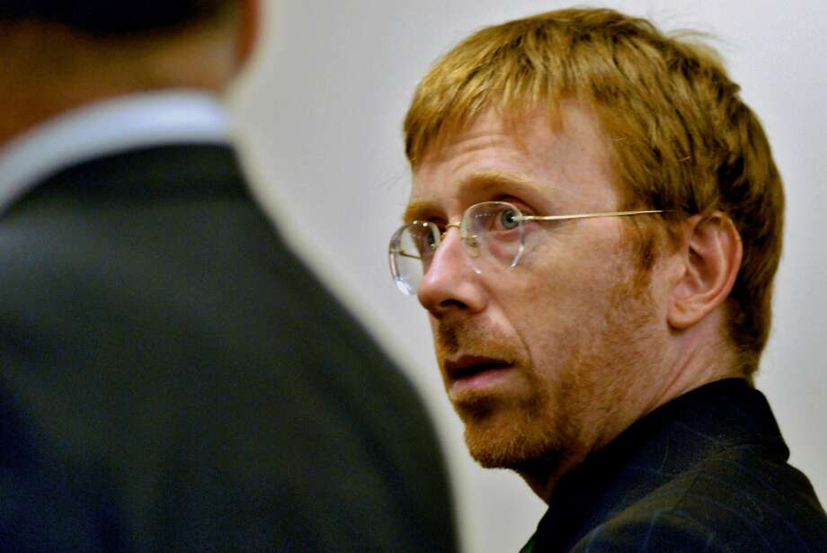 Times Union Staff photograph by Philip Kamrass --  Trey Anastasio, former lead singer for the rock band Phish, looks to his attorney Stephen Coffey, left, during his arraignment on drug charges in Washington County Court in Fort Edward, NY Tuesday February 27, 2007. He pleaded not guilty to the charges. FOR DANIELLE FURFARO STORY. (DG)
