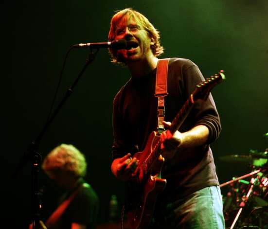 Special to the Times Union by Will Waldron -Phish front man Trey Anastasio bursts into song for the first night of a 2 day performance at the Pepsi, Albany, Friday September 8, 2000. (DG)