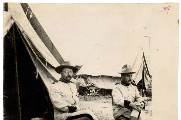 "Theodore Roosevelt - Before becoming Vice President and eventually President, Roosevelt came to San Antonio in 1898 to train with the U.S. 1st Volunteer Cavalry, the ""Rough Riders"" who won fame during the battle on San Juan Hill in the Spanish American War. Ernst Raba of San Antonio took this photo of Lt. Col. Theodore Roosevelt (left) and Col. Leonard Wood three months before the charge up San Juan Hill in Cuba."