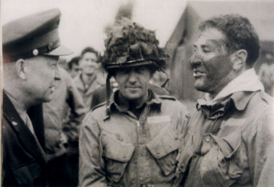 Robert G. Cole – Born in San Antonio, Cole was awarded the Medal of Honor during World War II. Pictured (left to right) Gen. Dwight Eisenhower, Col. Van Horn Mosely and Lt. Col. Robert Cole about nine and half hours before they jumped into France, the night before D-DAY. Photo: File Photo