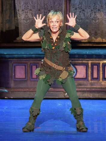 Peter Pan (Cathy Rigby) revels as he reunites with his shadow.