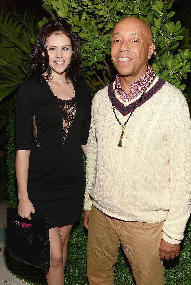 MIAMI BEACH, FL - DECEMBER 04:  Hana Nitsche (L) and Russell Simmons attend the Art Basel Miami Kick Off Celebration hosted by Jay Jopling & Nick Jones at Soho Beach House on December 4, 2012 in Miami Beach, Florida. Photo: Dimitrios Kambouris, Getty Images For Soho House / 2012 Getty Images