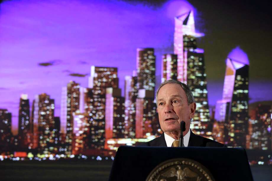 New York City Mayor Michael Bloomberg stands by by an artist's rendering of  a new neighborhood called Hudson Yards as he speaks during the ground breaking ceremony, Tuesday, Dec. 4, 2012 in New York. The 26-acre site on Manhattan's west side is the planned home for a new business district.  Those connected to the Hudson Yards plan envision millions of square feet of office space and housing, as well as a riverfront park and a cultural center. Photo: Mary Altaffer, AP / AP