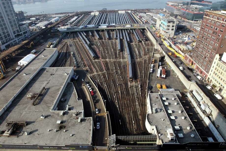 The area slated to be a new neighborhood called Hudson Yards is photographed, Tuesday, Dec. 4, 2012 in New York. The ambitious development is meant to transform the largest undeveloped property in Manhattan from an isolated rail yard into a sleek new neighborhood of spiky high-rises and graceful parks. Photo: Mary Altaffer, AP / AP