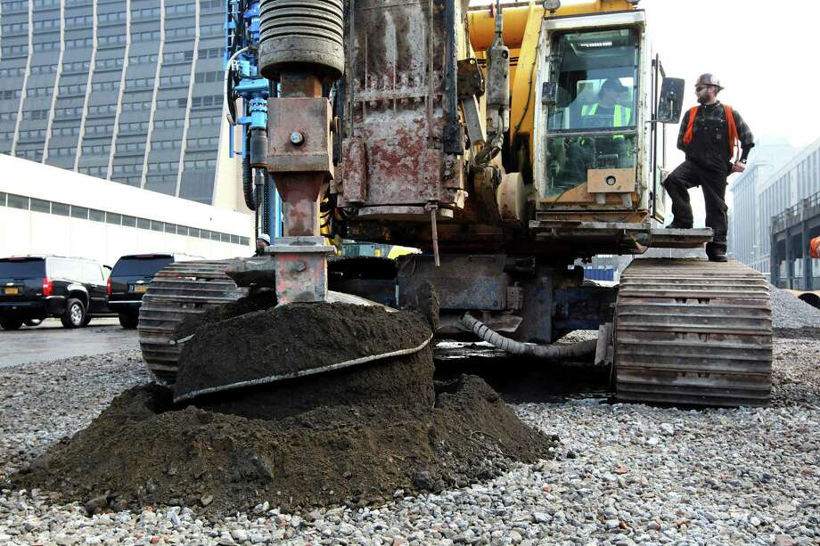 A BG 40 drill rig breaks ground for a new neighborhood called Hudson Yards, Tuesday, Dec. 4, 2012 in New York. The ambitious development is meant to transform the largest undeveloped property in Manhattan from an isolated rail yard into a sleek new neighborhood of spiky high-rises and graceful parks. Photo: Mary Altaffer, AP / AP