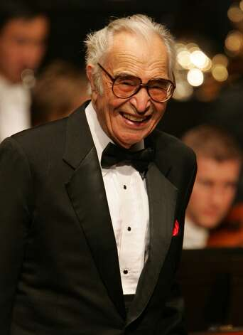 **FILE**  Legendary jazz pianist Dave Brubeck stands on stage following a performance to celebrate his 85th birthday at London's Barbican Hall in this Tuesday, Dec. 6, 2005 file photo.  Brubeck, who has written more than 45 religious works, including songs, hymns and carols, will be honored by the University of Notre Dame with its Laetare Medal.  The school will present the 85-year-old pianist with the medal,  considered the most prestigious honor for American Catholics,  during its May 21 commencement.     (AP Photo/Alastair Grant, FILE) (AP)