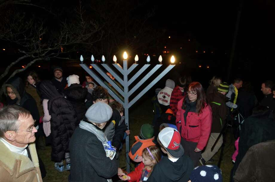 Residents gather for the menorah lighting at God's Acre Tuesday evening, the first night of Hanukkah. 12/20/2011. Photo by Jeanna Petersen Shepard Photo: Contributed Photo