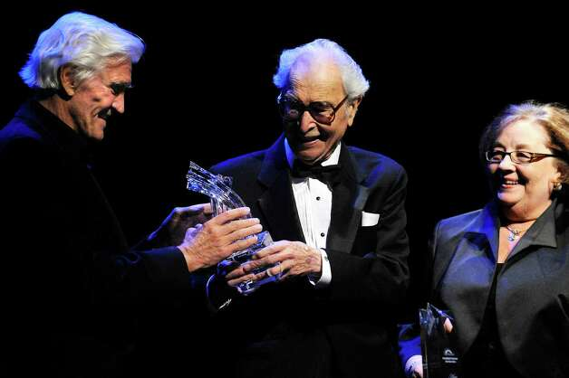 Dave Brubeck hands the SCA Arts Legacy Award off to actor David Canary after SCA Execuive Director Elissa Getto presented it to him in April 2010 at the Palace Theater in Stamford, Conn. Brubeck died Wednesday, Dec. 5, 2012 at Norwalk Hospital in Norwalk, Conn., said his longtime manager-producer-conductor Russell Gloyd. Photo: Keelin Daly, Keelin Daly/file Photo / Stamford Advocate