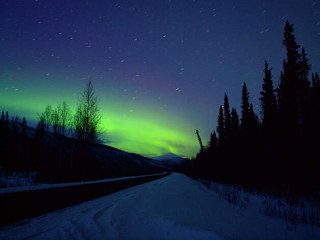 "2. Fairbanks, Alaska: ""Have you seen aurora borealis (aka the northern lights)? The sensation of seeing Arctic skies crackle with smoky blues, greens and reds has long drawn off-season travelers way north. 2013 will be big, marking the end of a fiery 11-year-cycle, when sunspots are particularly feisty, making for a big show in the Fairbanks sky 240 nights a year. Go. From May to mid-August daylight is too strong to see much, but by late summer they start to appear, and Fairbanks is the place to be. On the ground, curious foodies can sample traditional Athabascan cuisine at Taste of Alaska (call to book in advance) at the Morris Thompson Cultural & Visitors Center, or take part in a unique pub-crawl, The Great Fairbanks Pub Paddle. Open all year, the 414-mile Dalton Highway plies north of Fairbanks into the Arctic, and air taxis reach the pristine 800-sq-mile Gates of the Arctic National Park, but the light show will be best back in Fairbanks."" Photo: Young Juan/flickr"
